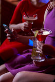 Three women with drinks Stock Image
