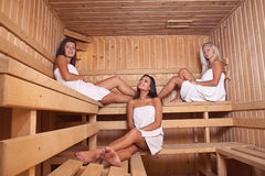Three women enjoying a hot sauna Stock Images
