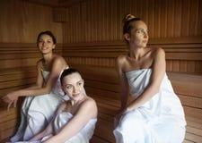 Three women enjoying a hot sauna Stock Photo