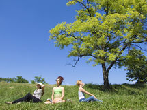 Three women enjoying the sun Stock Image