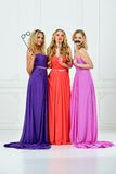 Three women in evening gown with masks. Royalty Free Stock Images