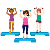 Three Women Exercise. Three beautiful active women doing aerobic exercise with dumbbell and steps Royalty Free Stock Photography