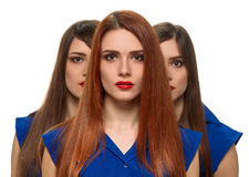 Three women faces. triplets sisters Stock Photos