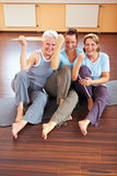 Three women with fists. Three happy women sitting in a gym Royalty Free Stock Photo