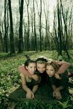 Three women in a forest Stock Image