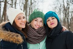 Free Three Women Friends Outdoors In Knitted Hats On A Snowy Cold Winter Weather. Royalty Free Stock Photos - 131417928