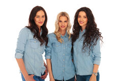 Three women friends standing together Royalty Free Stock Image