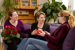 Three women gift flower bouquet Royalty Free Stock Image