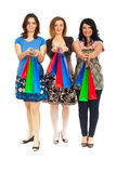 Three women giving shopping bags Stock Photography