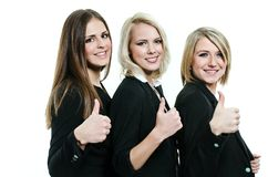 Three women giving thumbs up. Three happy and beautiful women giving thumbs up Royalty Free Stock Image