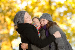 Three women happy embrace autumn Royalty Free Stock Photography