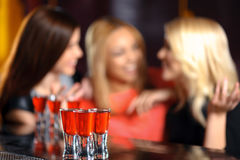 Three women have a drink in the bar Royalty Free Stock Photography
