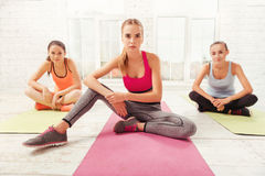 Three women having rest at gym Royalty Free Stock Photo