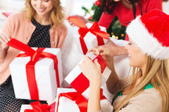 Three women holding many gift boxes Royalty Free Stock Image