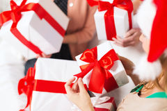 Three women holding many gift boxes Stock Image