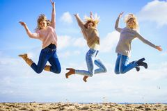 Three women jumping royalty free stock images