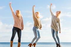 Three women jumping stock image