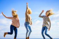 Three women jumping stock photography