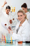 Three women in laboratory Stock Images