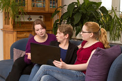 Three women with laptop arguing Stock Image