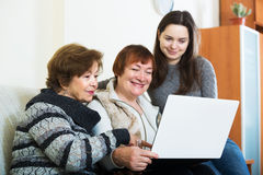 Three women with laptop Stock Photography