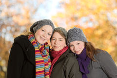 Three women leaning together october Royalty Free Stock Image
