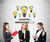 Three women light bulb loading Stock Photography