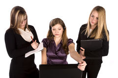 Three women looking at computer Stock Photography