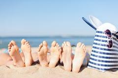 Three women lying on the beach Royalty Free Stock Photography