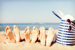 Three women lying on the beach Stock Photos