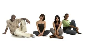 Three women and a man. Group of friends sitting stock photography