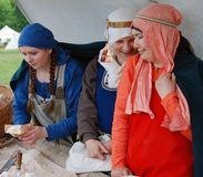 Three women in medieval costumes
