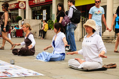 Three women meditating Royalty Free Stock Photography