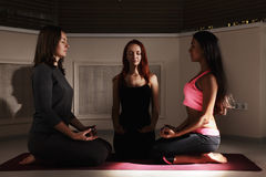 Three women meditating Stock Photos