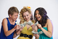 Three women with money in hands Royalty Free Stock Photos