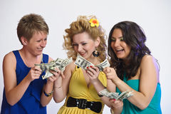 Three women with money in hands Stock Images