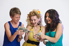 Three women with money in hands Royalty Free Stock Images