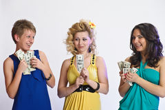 Three women with money in hands Stock Photos