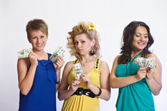 Three women with money in hands Stock Photo