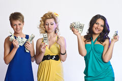 Three women with money in hands Royalty Free Stock Image