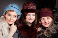 Three women mother and daughters  wearing felt hats in retro style Stock Photo
