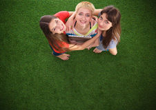 Three women with naked feet standing in grass Royalty Free Stock Images