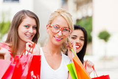 Three Women Out In Town Shopping Stock Images