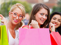 Three Women Out In Town Shopping Royalty Free Stock Photos