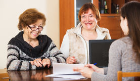 Three women with papers Royalty Free Stock Photography
