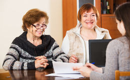 Three women with papers Royalty Free Stock Photo
