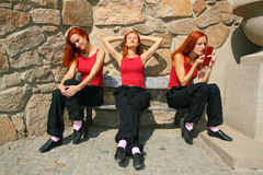 Three women on park bench Royalty Free Stock Image