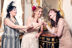 Three women partying retro style Stock Photo