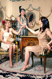 Three women partying retro style Royalty Free Stock Photography