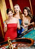 Three women playing roulette Stock Photos